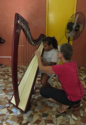 Canadian harpist Gianetta Baril teaching a young student in Rio de Janeiro.